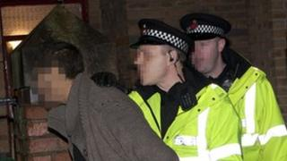 Man being arrested during police raid