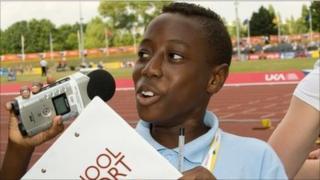 A School Reporter recording audio