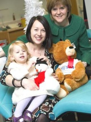Health Secretary Nicola Sturgeon, Fiona Christie with daughter, Rosa