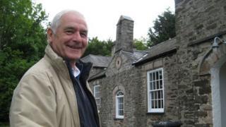 David Rowley outside Llanrhos Old School