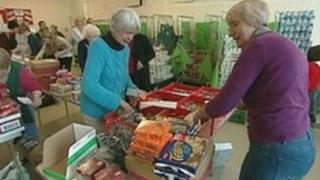 Salvation Army volunteers packing food parcels in Reading