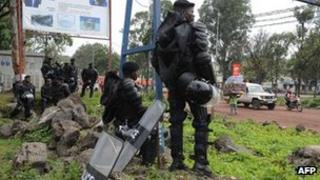 Congolese riot police stand guard on the streets of Goma