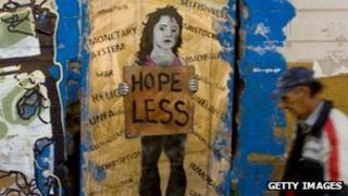 "Graffiti image showing a women carrying a sign saying ""hope less"""