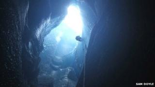 Abseiling into a moulin formed by rapid lake drainage