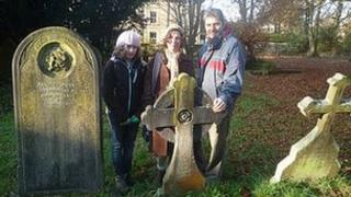 Volunteer Bridget Maddison and family with the grave they adopted (pic Jean Luton)