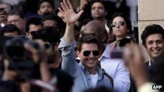 Tom Cruise waves to the crowd outside the Mumbai airport on Saturday 3 December 2011