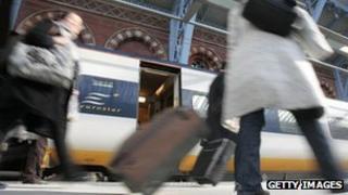 Passengers getting off Eurostar train at St Pancras