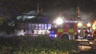 The fire has burned through the thatched roof