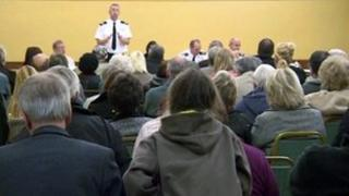 Firefighter standing up addressing public