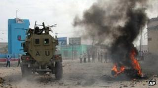 African Union troops at the scene of a suicide bombing in Mogadishu (6 December)