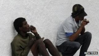 Two men smoke crack cocaine in Sao Paulo