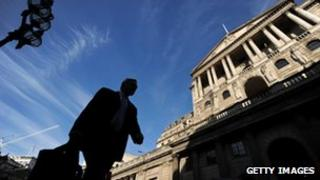 Man walking past Bank of England building