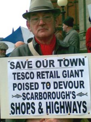 Campaigner holding placard