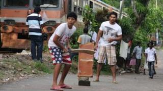 Sri Lankans playing cricket