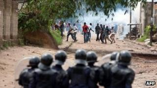 "Around 100 youth of the ""Pompage"" district confront with police during a protest in Kinshasa on December 7, 2011"