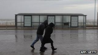 A couple in the wind in Blackpool