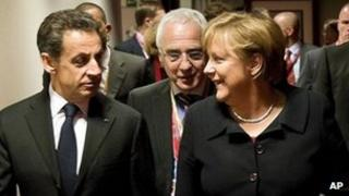 French President Nicolas Sarkozy (left) and German Chancellor Angela Merkel (right) in Brussels