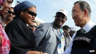 """UN Secretary General, Ban Ki-moon (C) shakes hands with Somali women as he stands next to Somali Prime Minister Abide Mohamed Ali (R) after his arrival at Mogadishu""""s Adan Abulle airport, Somalia on December 9, 2011."""