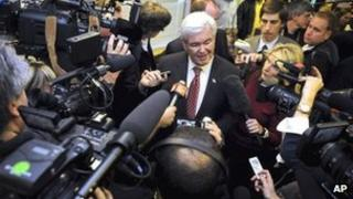 Former House Speaker Newt Gingrich surrounded by cameras 30 November 2011