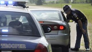 Alabama Department of Public Safety's Sgt. Steve Jarrett talks to a driver he stopped in Montgomery, Ala