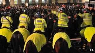 DR Congo protesters and police in Whitehall on Tuesday, 6 December