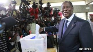 President Alassane Ouattara casts his ballot at a polling station in Cocody on 11 December 2011