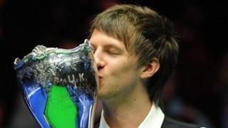 England's Judd Trump celebrates with the trophy after winning the williamhill.com UK Championships at the Barbican Centre, York. Picture: Anna Gowthorpe/PA Wire