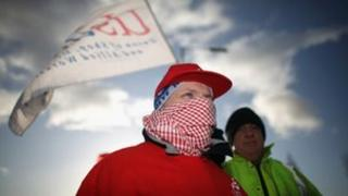 Workers at Unilever's Port Sunlight factory picket outside the main gates of their factory on the Wirral, Merseyside, on 9 December 2011.
