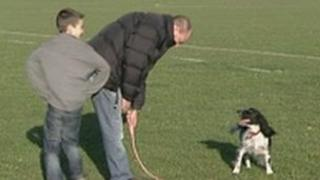 Neil Downing and his son Jack, with their medical alert dog Roots