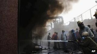 Firefighters work to extinguish the fire at the Calcutta hospital on 9 Dec 2011