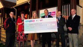 Sport England presents a cheque to Cumnor Cricket Club