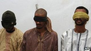 Three men presented as the kidnappers of two Frenchmen snatched in Hombori north east of Mali on November 24, are shown to the press on December 12, 2011 in Bamako.