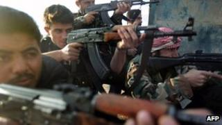 Soldiers of the Free Syrian Army, formed by army deserters, 7 December