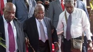 Papua New Guinea Prime Minister Michael Somare (C) and his cabinet and ministers at Government House in Port Moresby on December 14,