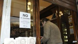 "A shop in Florence displaying a sign which reads ""No to racism!"""