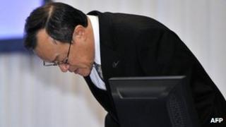 President Shuichi Takayama bows
