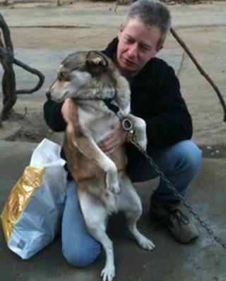John Bagley with Husky, the Romanian dog he adopted
