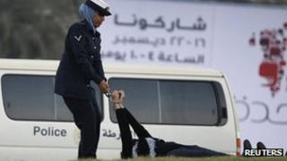 Zainab al-Khawaja being dragged by a policewoman after being arrested in Manama (15 December 2011)