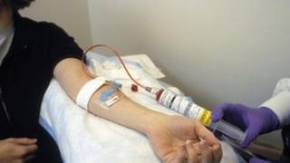 Woman receiving intravenous chemotherapy