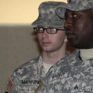 Bradley Manning (L) is escorted from the court at Fort Meade, Maryland, on 16 December 2011