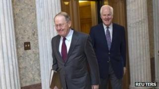 Republican Senators Lamar Alexander (L) and John Cornyn arrive at the Capitol - 17 December 2011