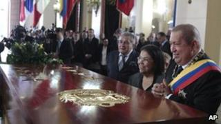 Venezuela's President Hugo Chavez, right, looks at the new coffin containing the remains of Simon Bolivar at the National Pantheon, Caracas, on 17 December 2011