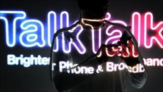 TalkTalk logo with silhouette of person on phone