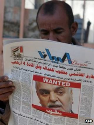 "An Iraqi man in Baghdad reads a local newspaper, featuring a front page picture of Vice-President Tareq al-Hashemi with the word ""wanted"" above his face, on December 20, 2011."