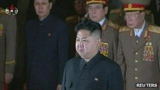 Kim Jong-un (foreground) pays his respects as Kim Jong-il lies in state in the capital Pyongyang (20 December)