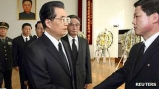 Chinese President Hu Jintao shakes hands with North Korean charge d'affaires Pak Myong-ho at the North Korean embassy in Beijing, as he expresses condolences on the death of Kim Jong-il, 20 December 2011