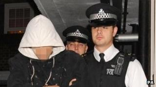 Riot suspect arrested