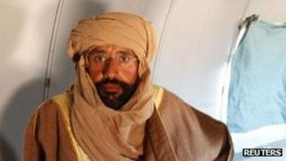 Saif al-Islam after his capture, on board plane to Zintan (19/11/11)
