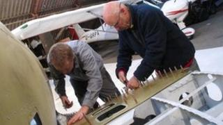 Members of Enstone Flying Club building the first of 12 Mk 26B Spitfires