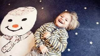 Child with snowman picture